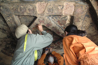 Researchers restoring the caves. Credits: National Research Institute for Cultural Properties, Tokyo (Japan).