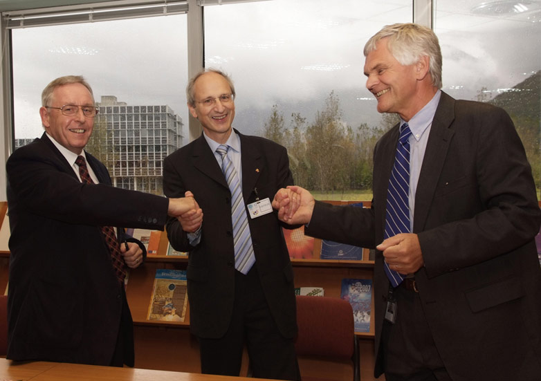 From left to right, Prof. William G. Stirling, Prof. Farid Ouabdesselam, Prof. Richard Wagner celebrating the agreement