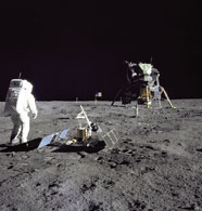 Placing a seismometer on the moon during the Apollo 11 mission.